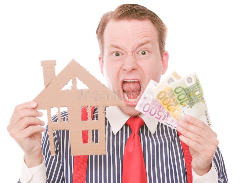 Frustrierter Geschäftshauseigentümer mit Geld stockbild