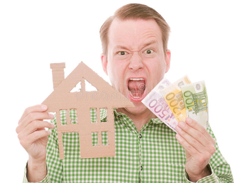 Frustrierter Hauseigentümer mit Geld lizenzfreies stockbild