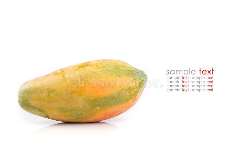 Fruta amarilla de la papaya aislada en el fondo blanco fotos de archivo
