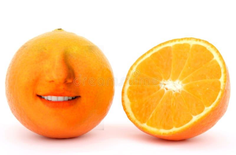 Fruta anaranjada única que sonríe foto de archivo