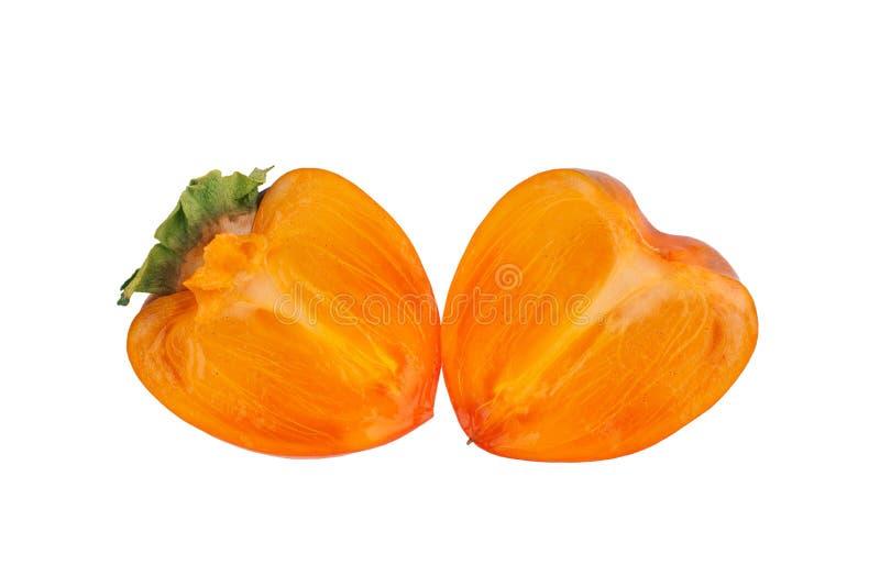 Fruta anaranjada del caqui con las hojas verdes cortadas por la mitad dos en cierre aislado fondo blanco para arriba foto de archivo libre de regalías