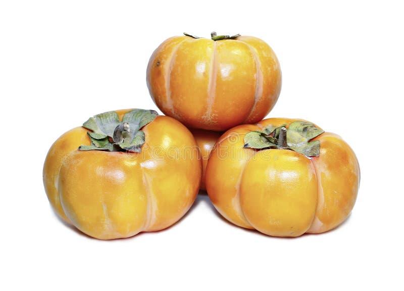 Fruta anaranjada jugosa del caqui aislada foto de archivo libre de regalías