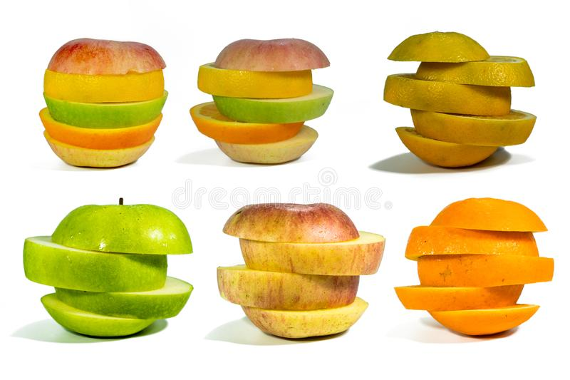 Fruta cortada, apilada aislado para añadir las trayectorias en un fondo blanco fotografía de archivo libre de regalías