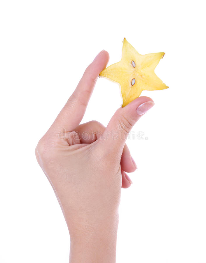 Fruta de estrella rebanada a disposición aislada en blanco imagen de archivo libre de regalías