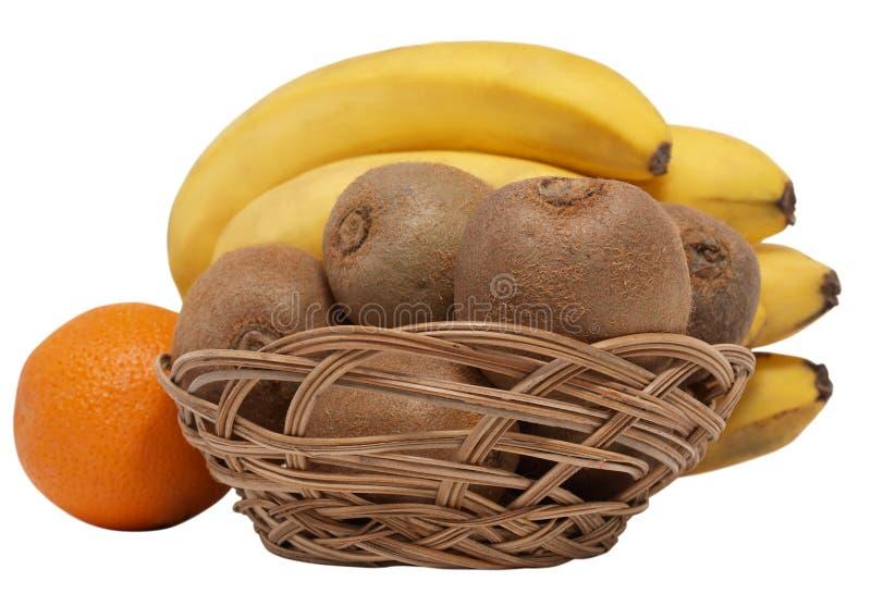 Fruta de kiwi en la cesta fotos de archivo