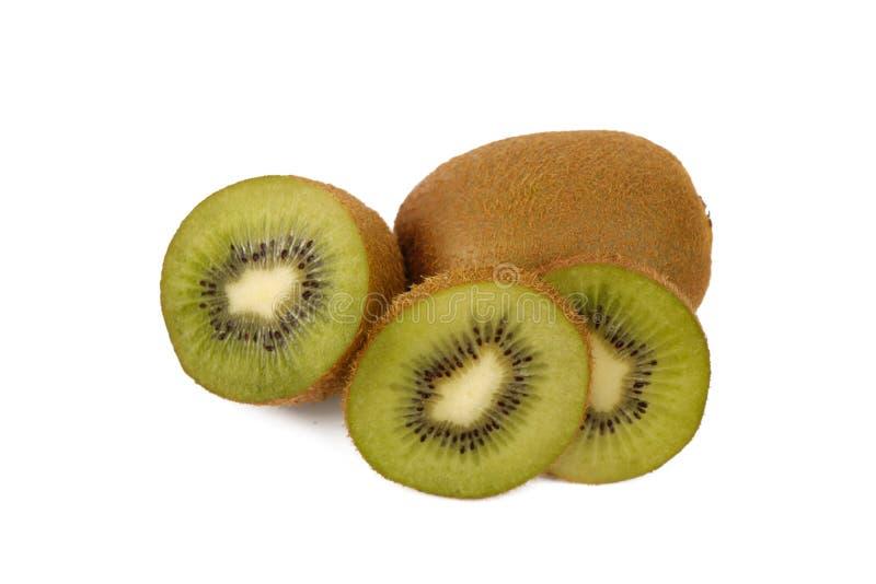 Fruta de kiwi - kiwis cortados frescos aislados en blanco fotografía de archivo