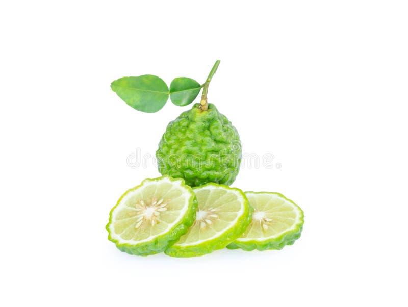 Fruta de la bergamota con la rebanada de la hoja aislada en el fondo blanco, FRU imágenes de archivo libres de regalías