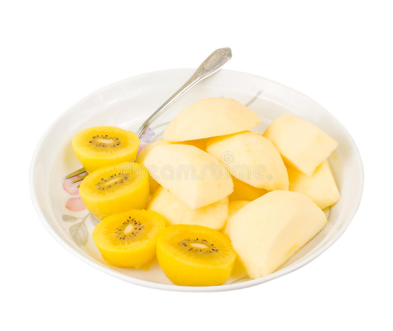 Fruta de quivi dourada e maçã cortada com forquilha fotografia de stock