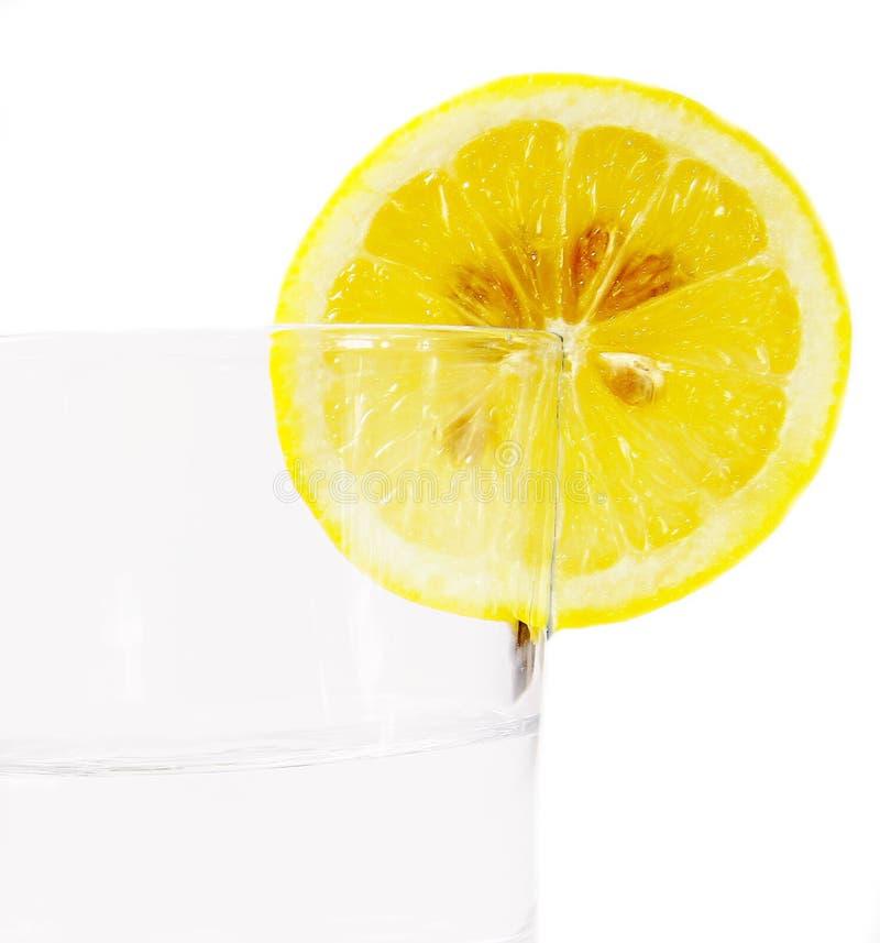 Fruta del limón con el vidrio foto de archivo