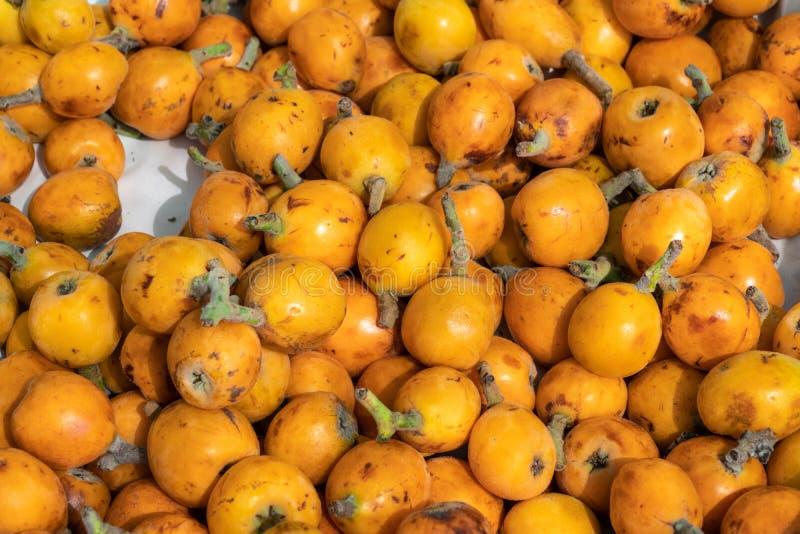 Fruta del Loquat o fondo de los nísperos japoneses fotos de archivo