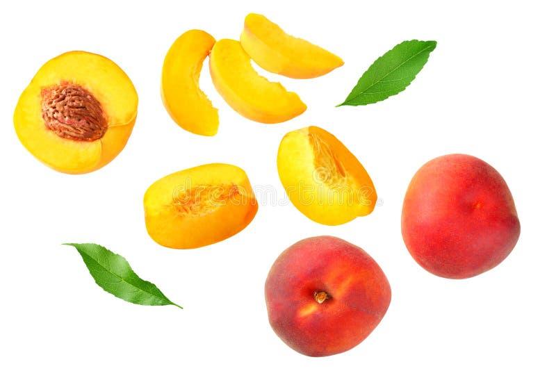 fruta del melocot?n con la hoja verde y rebanadas aisladas en el fondo blanco Visi?n superior foto de archivo