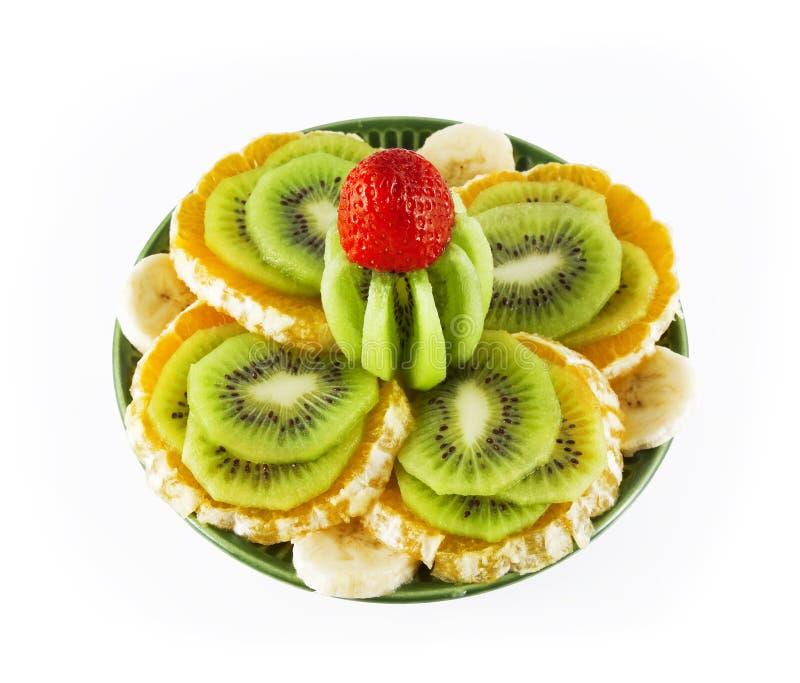 Fruta em um saucer verde fotos de stock royalty free