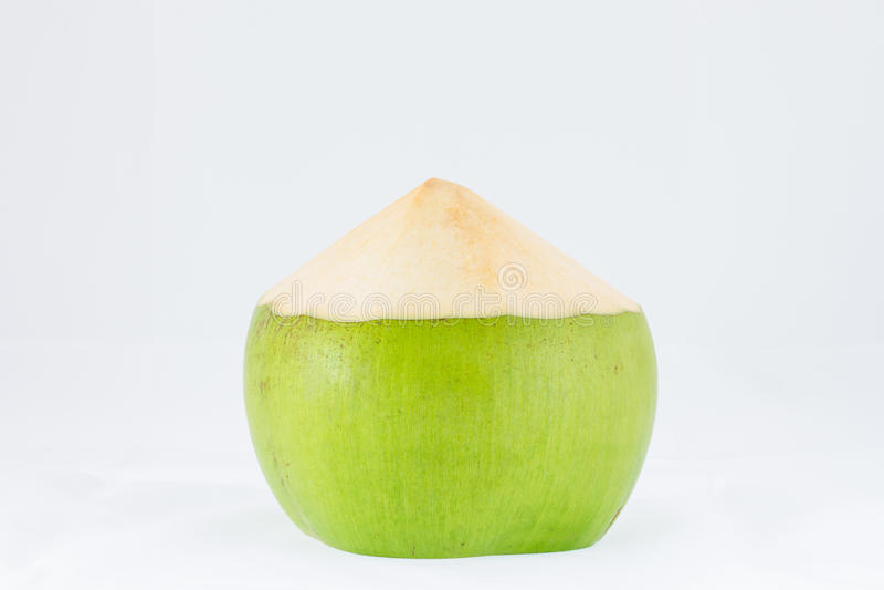 Fruta joven del coco en el fondo blanco foto de archivo