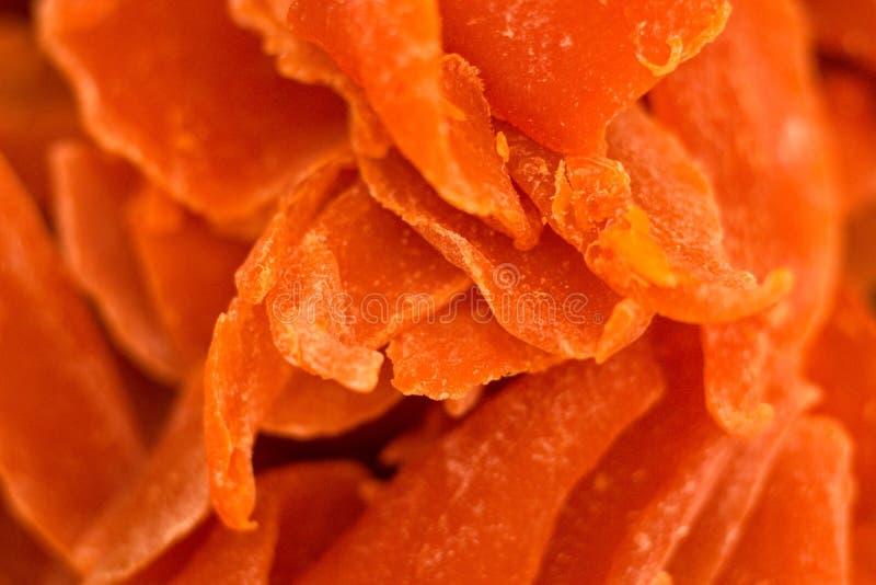 Frutas cortadas secadas de sombreros anaranjados anaranjados sabrosos foto de archivo libre de regalías