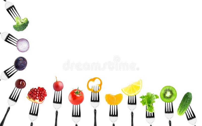 Frutas e legumes na forquilha ilustração do vetor