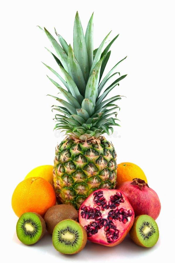 Frutas exóticas en el fondo blanco imagen de archivo