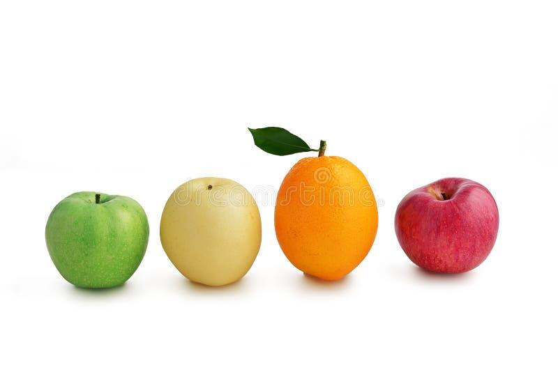 Frutas mezcladas, manzana anaranjada y verde de la pera blanca de la manzana roja foto de archivo