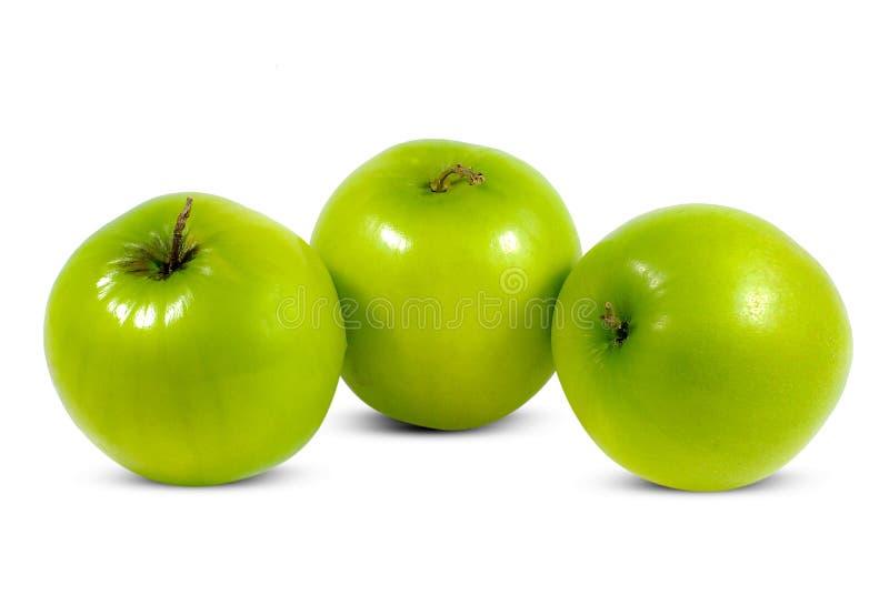 Frutas verdes de la azufaifa aisladas en blanco fotografía de archivo