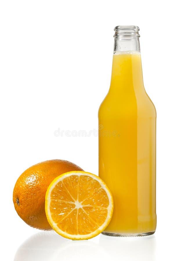 Frutas y jugo anaranjados fotografía de archivo libre de regalías