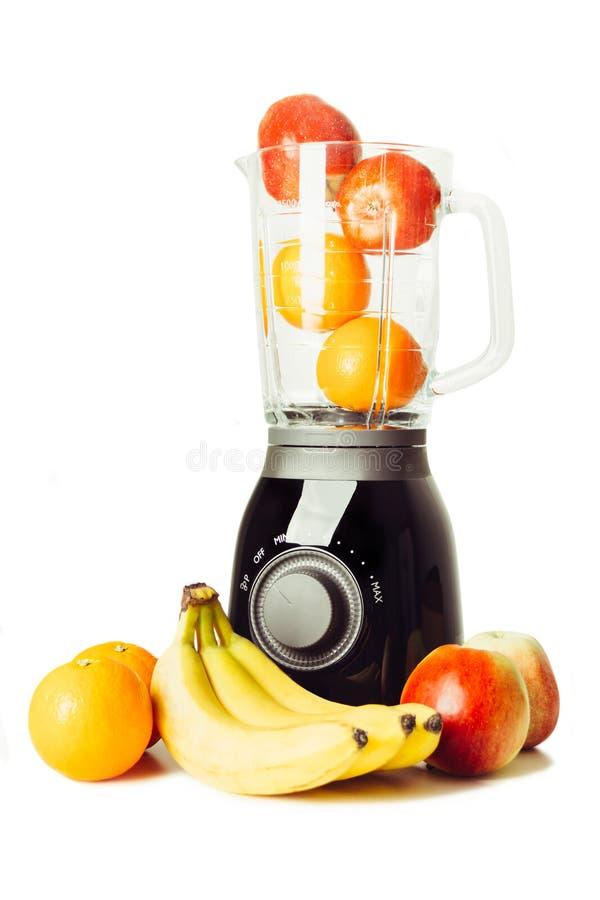 Frutas y licuadora imagenes de archivo