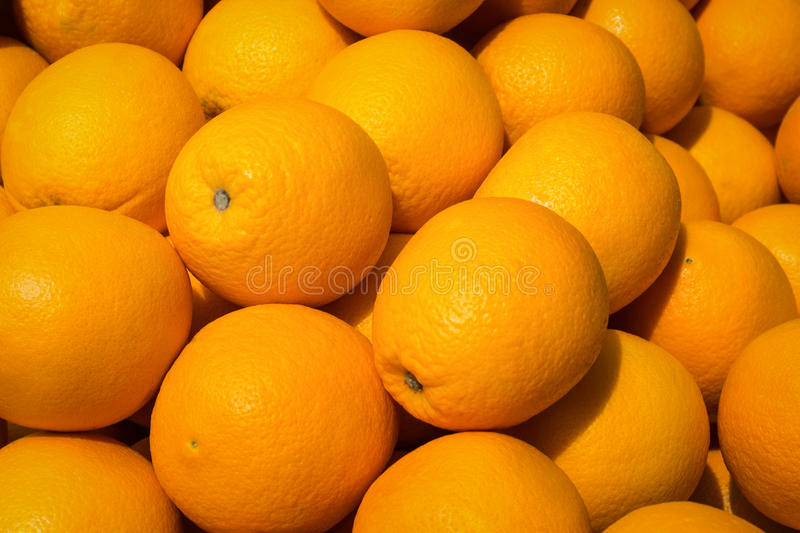 Fruto alaranjado - fundo das laranjas fotografia de stock royalty free