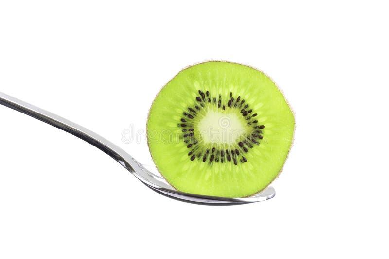Fruto de quivi verde transparente fresco e suculento cortado na sagacidade da colher fotos de stock