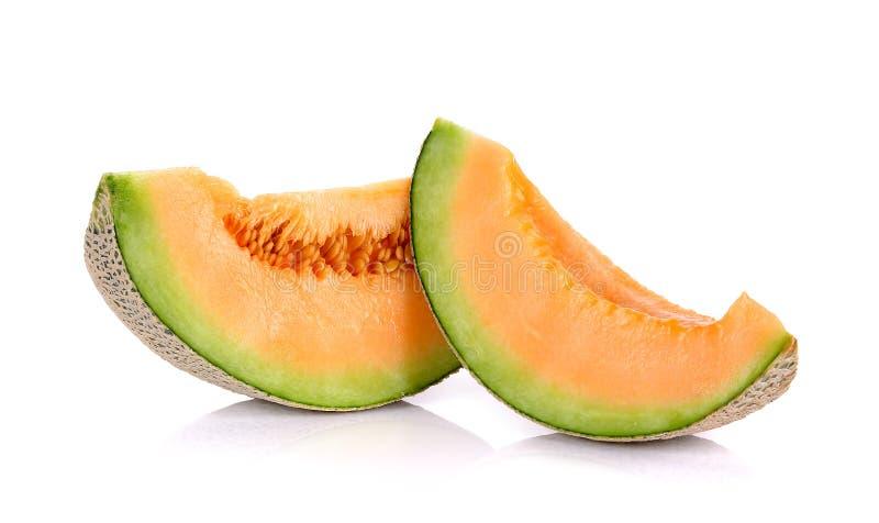 Fruto do melão das fatias isolado no fundo branco foto de stock royalty free