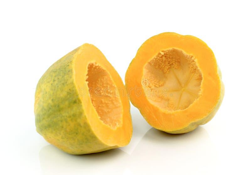 Frutos maduros da papaia no fundo branco imagens de stock royalty free