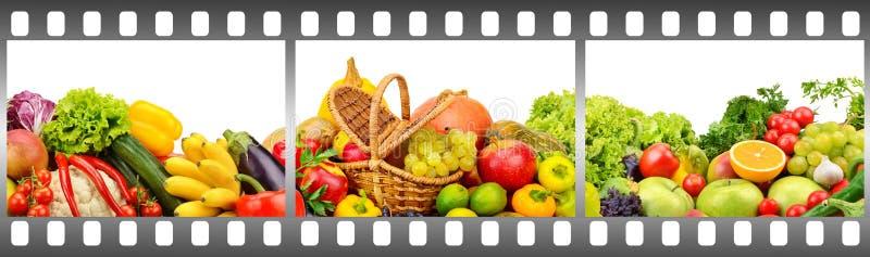 Frutta e verdure mature nel telaio fatto della pellicola fotografica immagini stock libere da diritti
