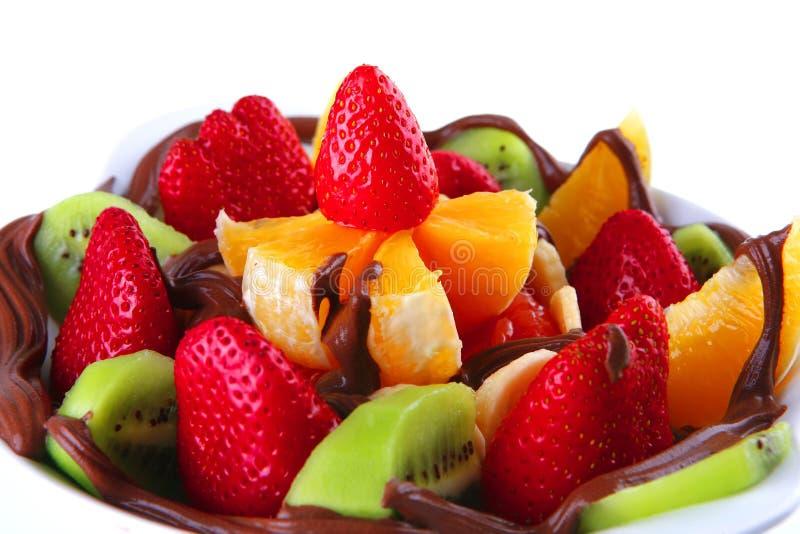 Frutta grezza con cioccolato fotografia stock