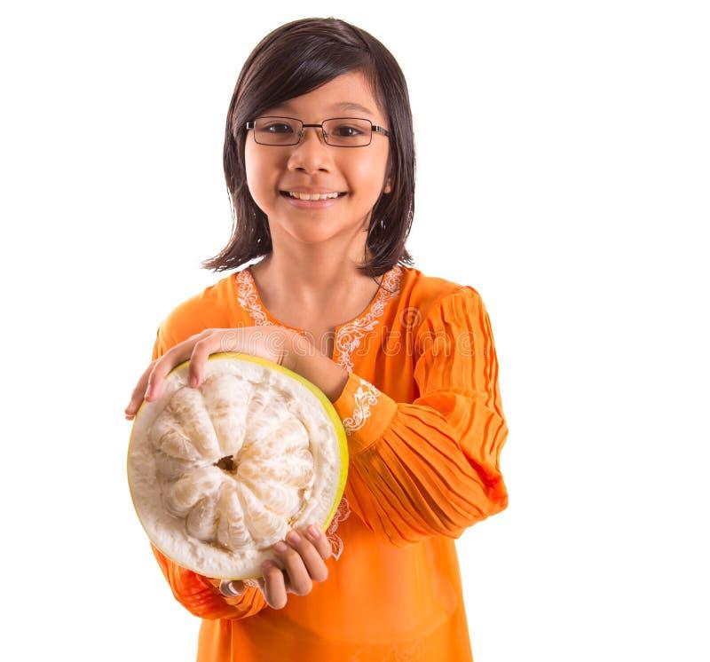 Frutta malese IX del pomelo e della ragazza immagini stock libere da diritti