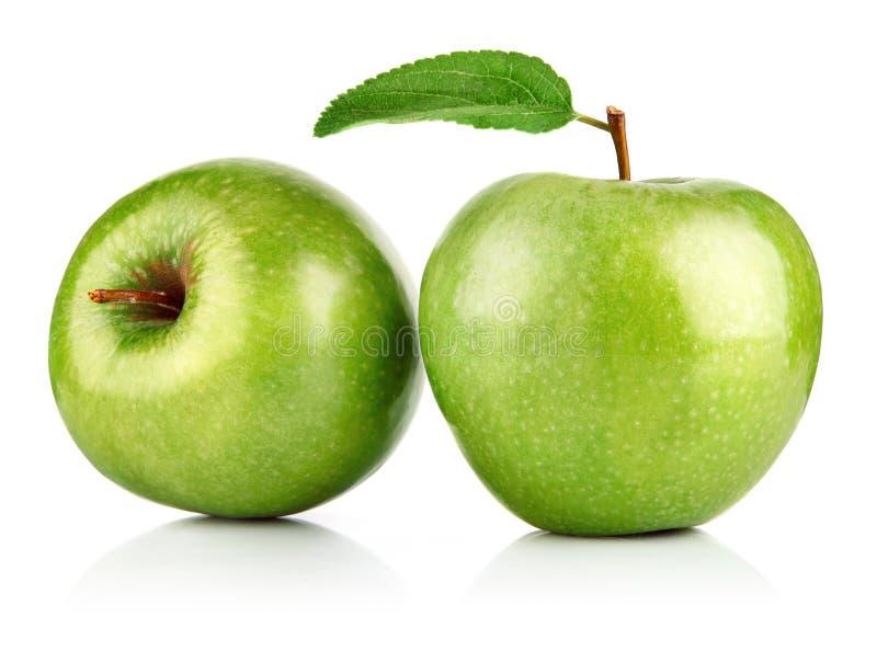 Frutta verde della mela con il foglio fotografie stock