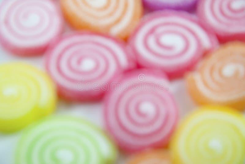 Frutti della gelatina della miscela sulla sfuocatura astratta del fondo fotografia stock libera da diritti