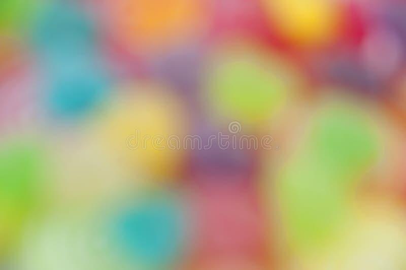 Frutti della gelatina della miscela sulla sfuocatura astratta del fondo fotografie stock