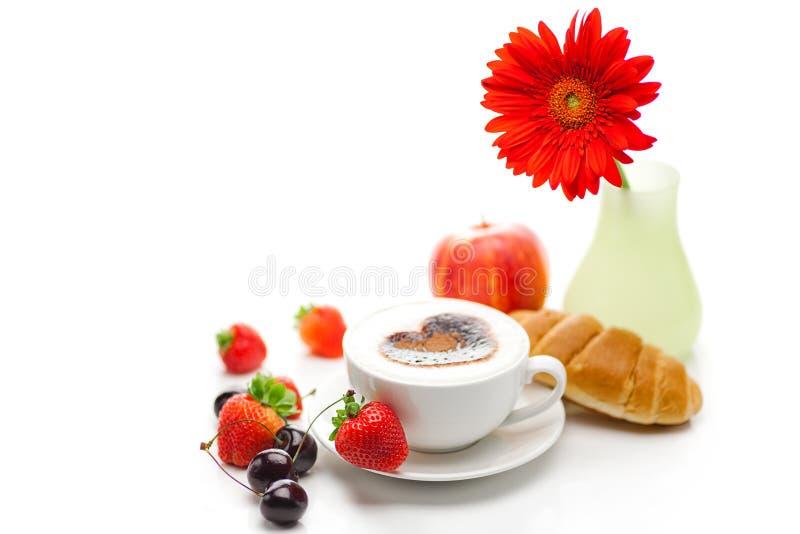 Frutti e cappuccino fotografie stock