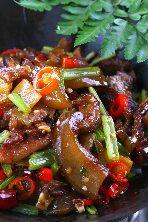 Fry asian food. Asian food. Stir fry of pork and vegetables royalty free stock photography