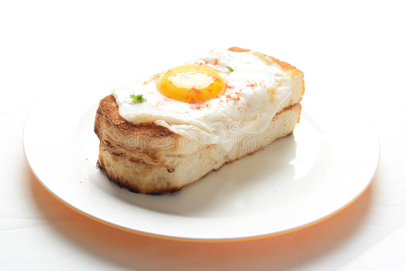 Fry egg with toast. As breakfast royalty free stock image