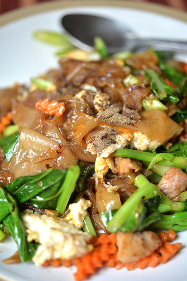 Fry Noodle. Close up stir fry noodle with pork and sweet soy sauce, Pad See ew royalty free stock images