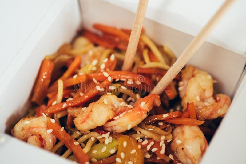 Fry noodles - traditional Chinese WOK with fried chicken, udon and vegetables, close up royalty free stock photography