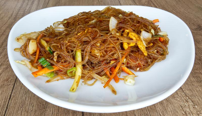 Fry noodles with vegetables and eggs. Asian traditional food: Yasai stock image