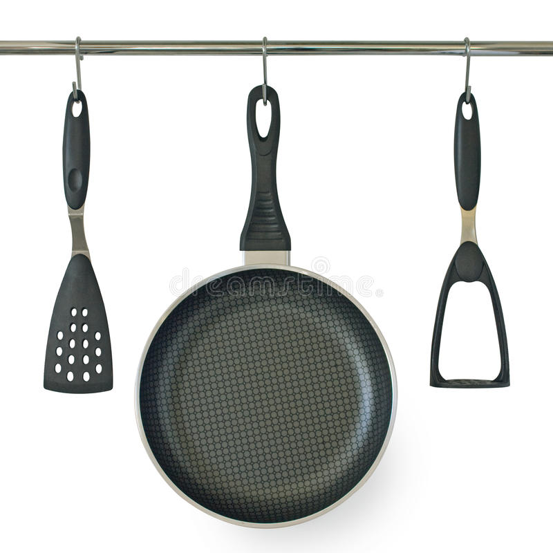 Free Fry Pan And Kitchen Utensils Hanging On A Rail Stock Image - 13908391
