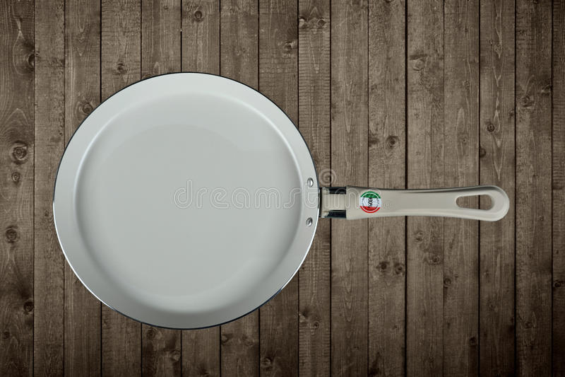 Fry pan on wooden stock image