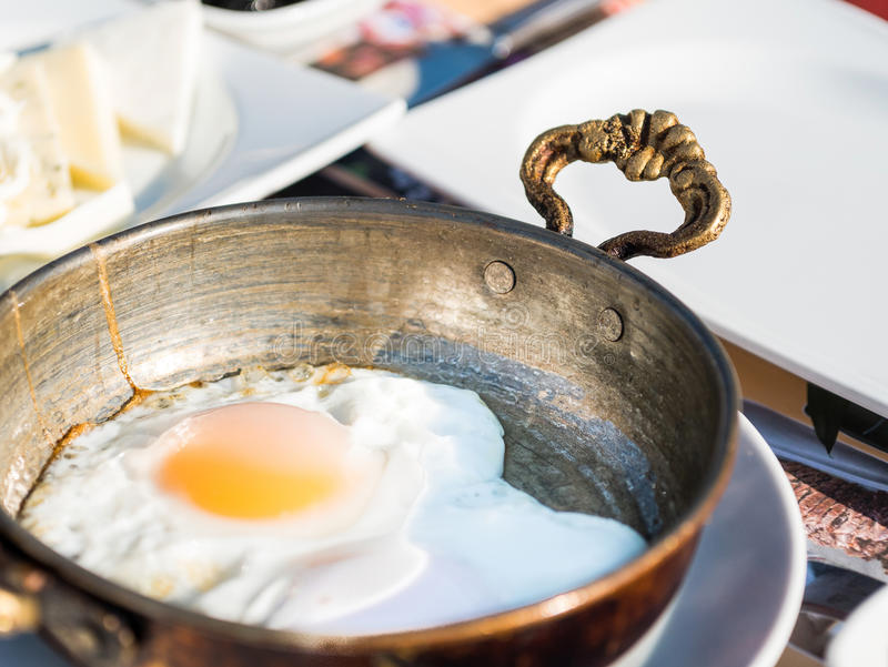 Fry sunny eggs in a serving pan. Fry sunny eggs in a silver serving pan royalty free stock photo
