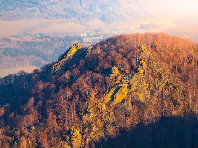 Frydlatske cimburi granite rock formation on the ridge in the middle of beech forest of Jizera Mountains, Czech Republic stock photography