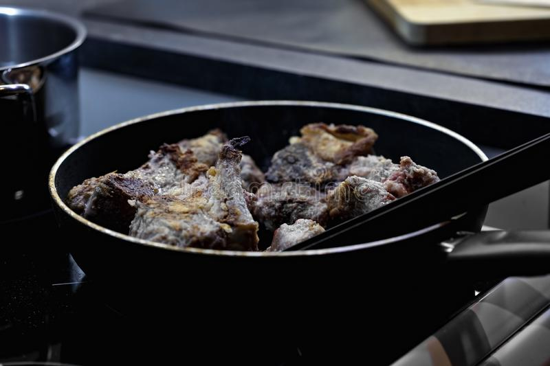 Frying beef in a pan stock photos