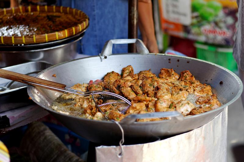 Frying Fish Cakes Tod Man Pla in big pan.Street food in local market.  stock photo