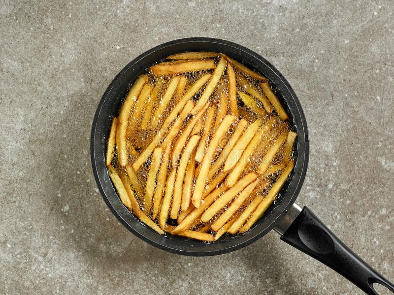 Frying french fries stock photo