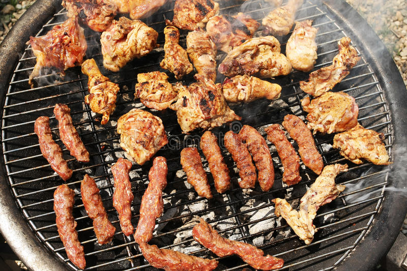 Frying meat grill royalty free stock image