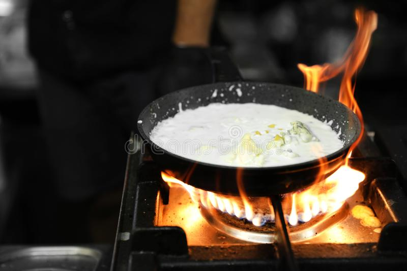 Frying pan with cheese and cream stock image