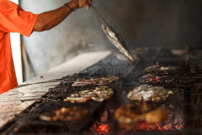 Frying seafood on a grill stock images